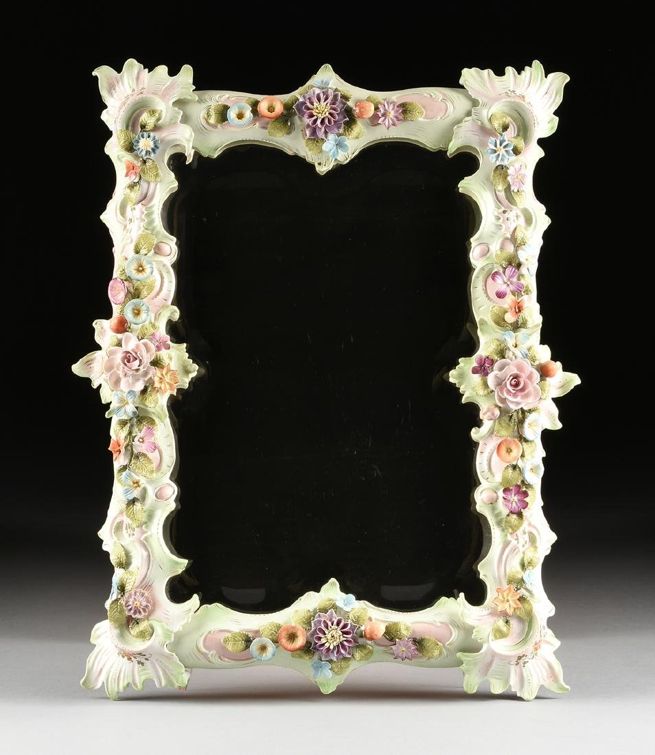A CONTINENTAL PAINTED AND FLORAL ENCRUSTED PORCELAIN