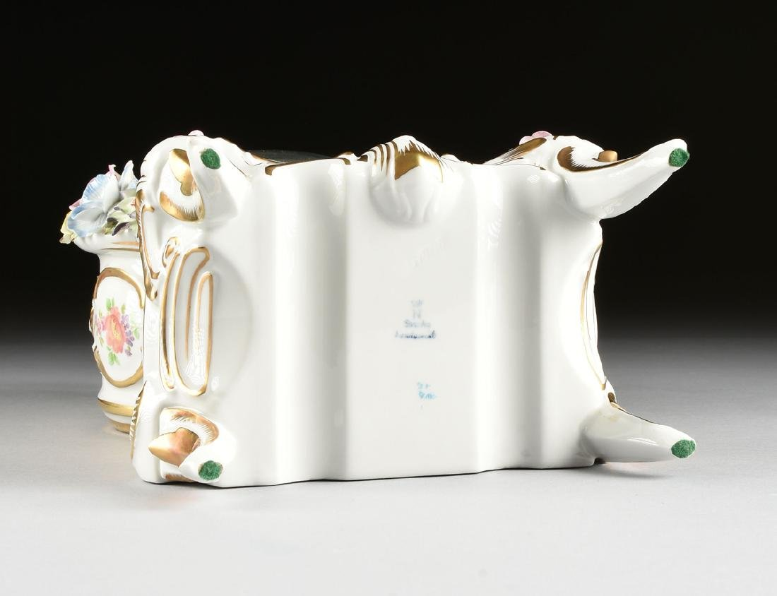A DRESDEN FLORAL ENCRUSTED AND PAINTED PORCELAIN MANTLE - 10