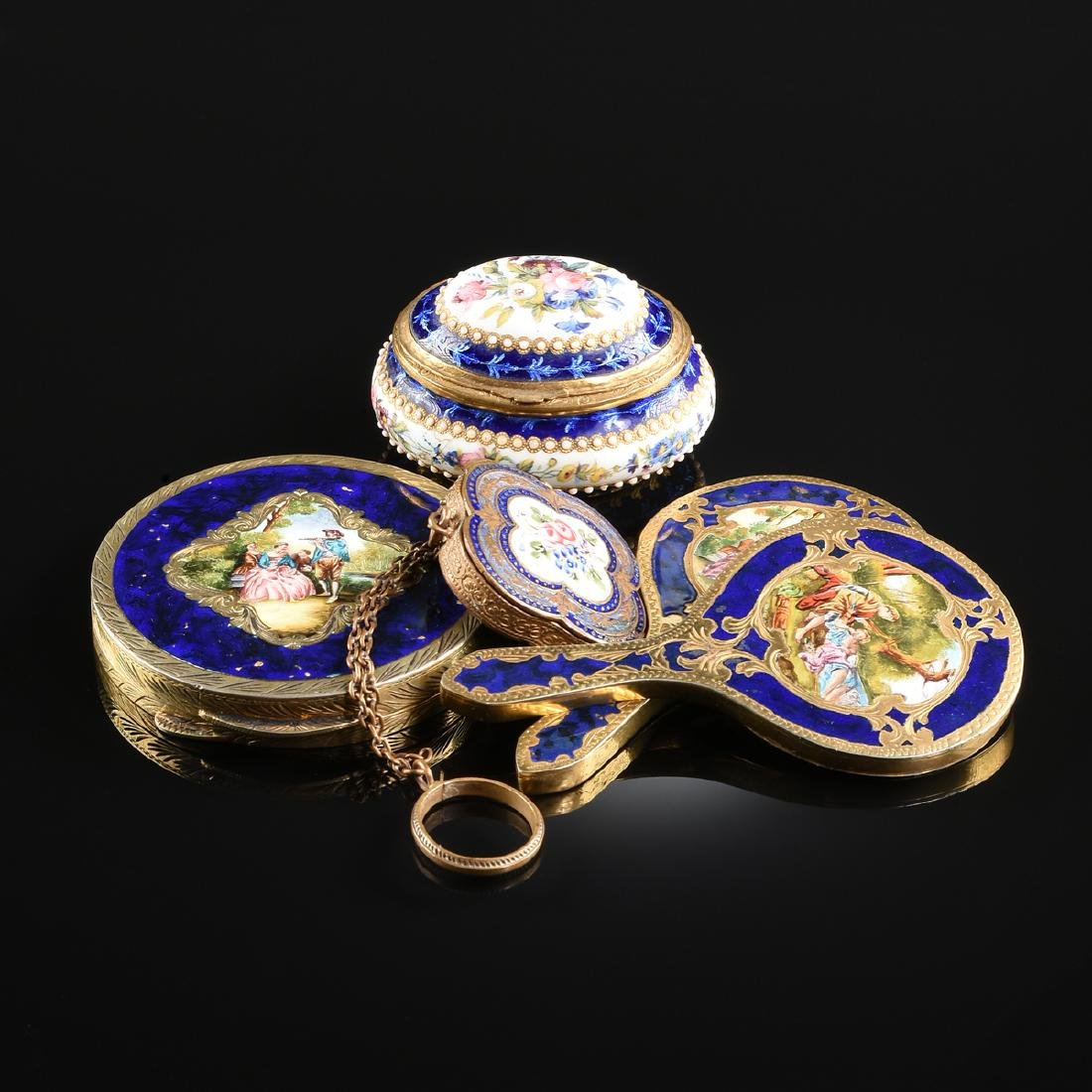 A GROUP OF FIVE ANTIQUE DIMINUTIVE GILT METAL AND