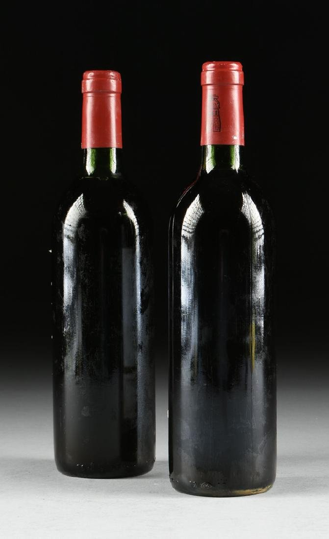 A GROUP OF TWO BOTTLES OF 1983 GRAND VIN DE CHÂTEAU - 6