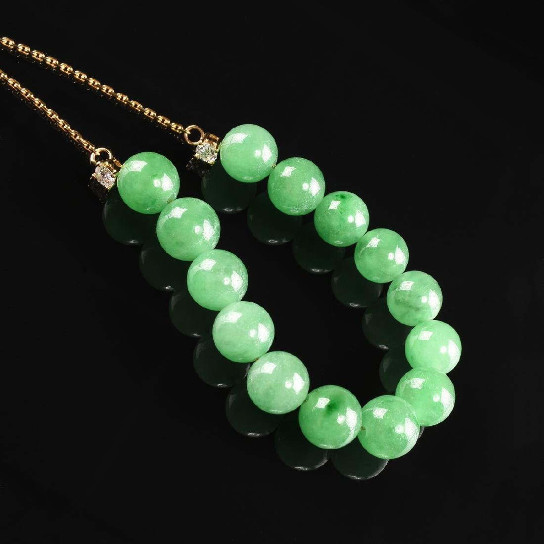 AN 18K YELLOW GOLD, JADE, AND DIAMOND LADY'S JADE