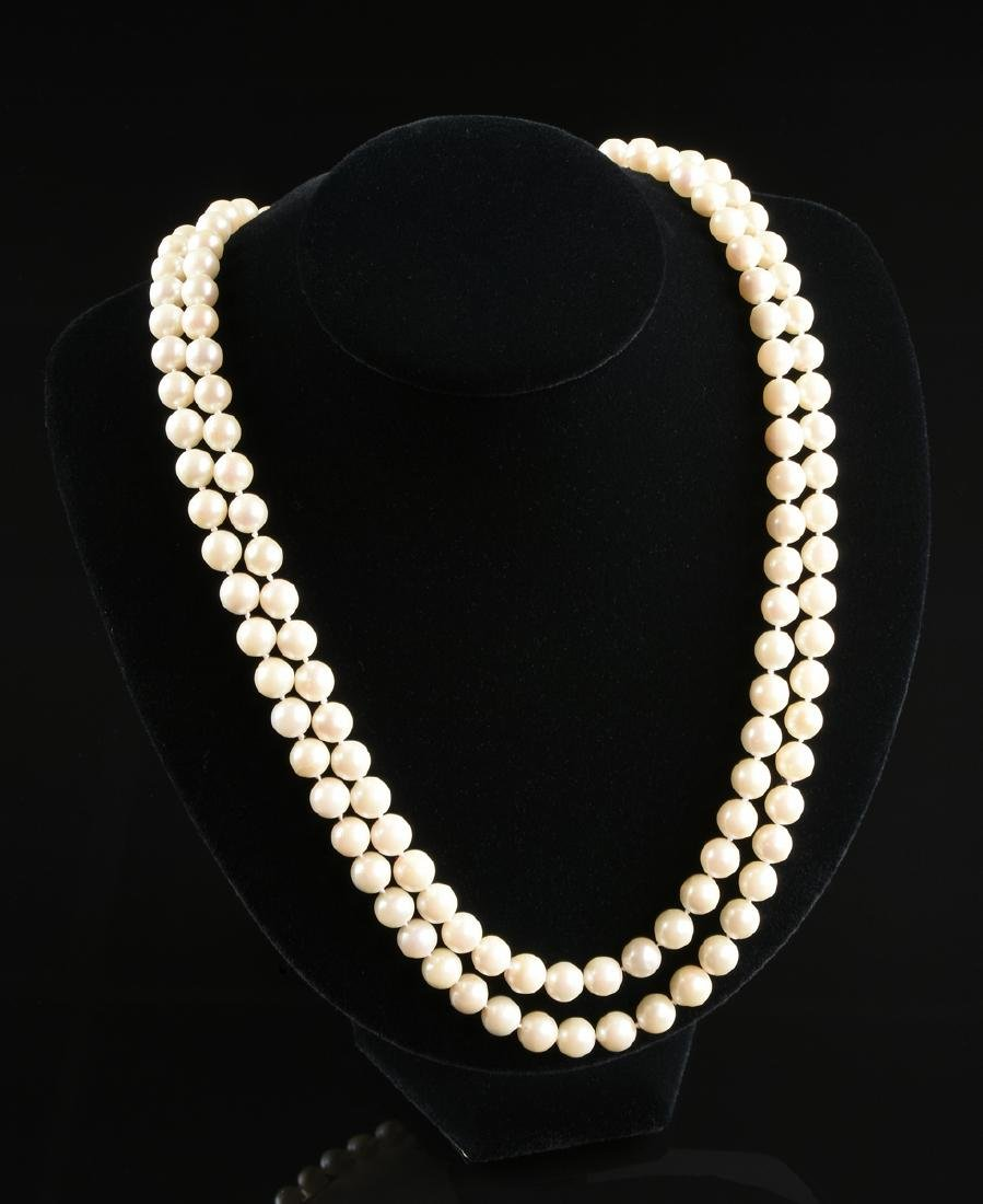 A DOUBLE STRAND AKOYA CULTURED PEARL NECKLACE WITH A