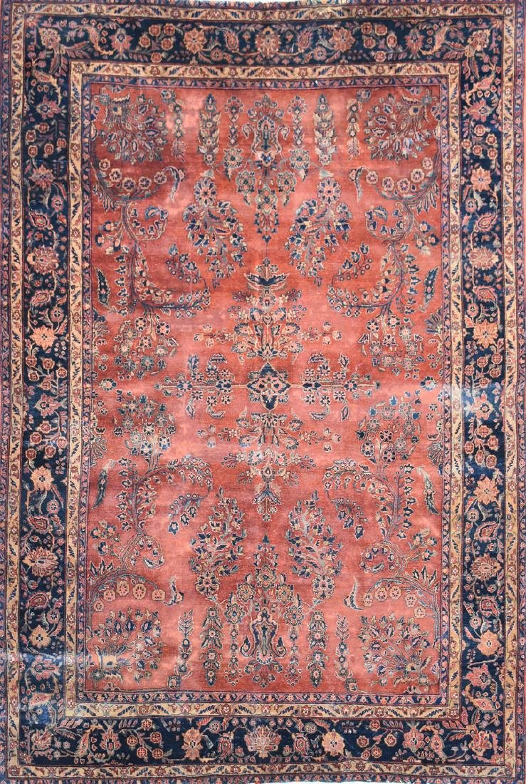 AN ANTIQUE PERSIAN HAND WOVEN WOOL RUG, SAROUK, CENTRAL