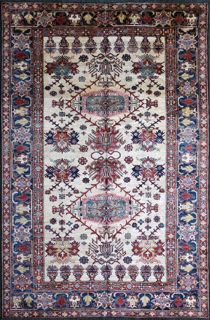 A TURKISH HAND KNOTTED WOOL RUG, POSSIBLY MELEZ, CIRCA