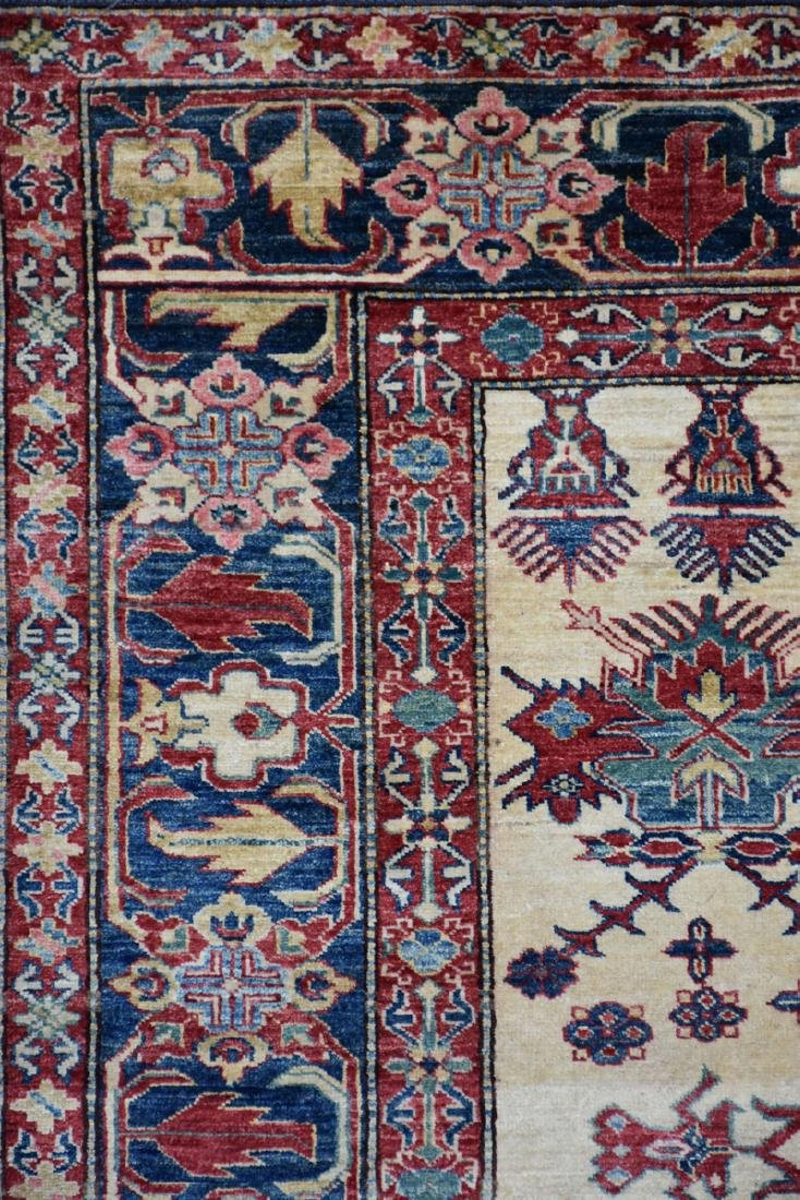 A TURKISH HAND KNOTTED WOOL RUG, POSSIBLY MELEZ, CIRCA - 2
