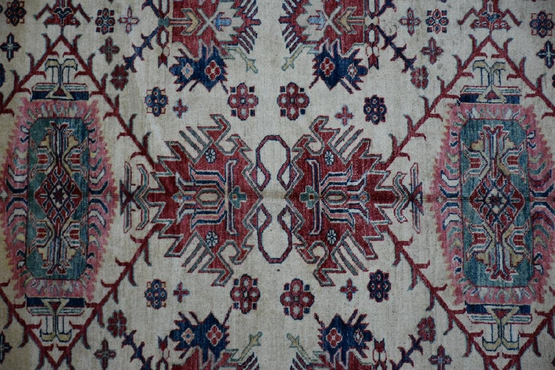 A TURKISH HAND KNOTTED WOOL RUG, POSSIBLY MELEZ, CIRCA - 4