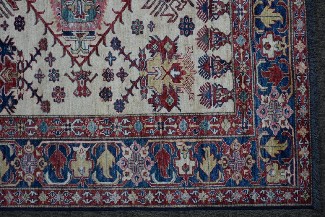 A TURKISH HAND KNOTTED WOOL RUG, POSSIBLY MELEZ, CIRCA - 5