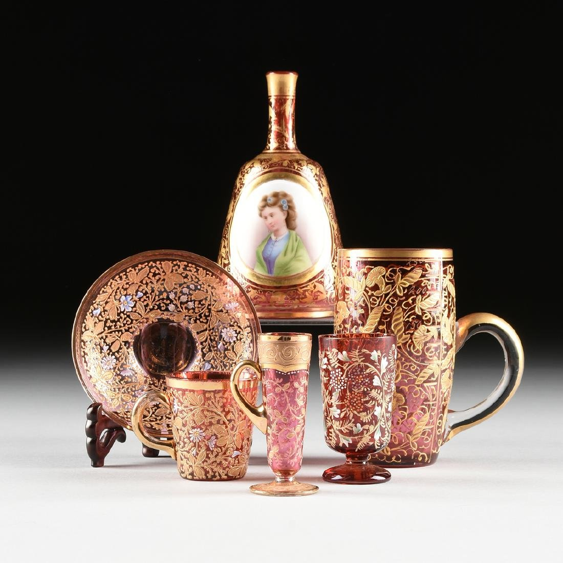 A GROUP OF SIX LUDWIG MOSER & SOHNE GILT DECORATED