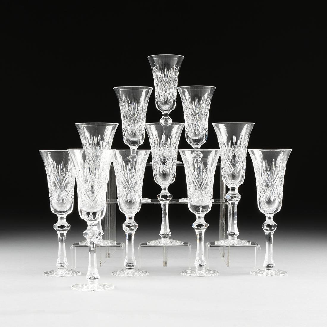 A SET OF ELEVEN WATERFORD CUT CRYSTAL CHAMPAGNE FLUTES