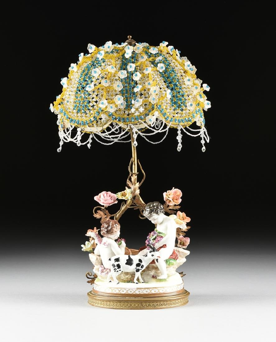 A GERMAN PAINTED PORCELAIN FIGURAL GROUP LAMP, POSSIBLY