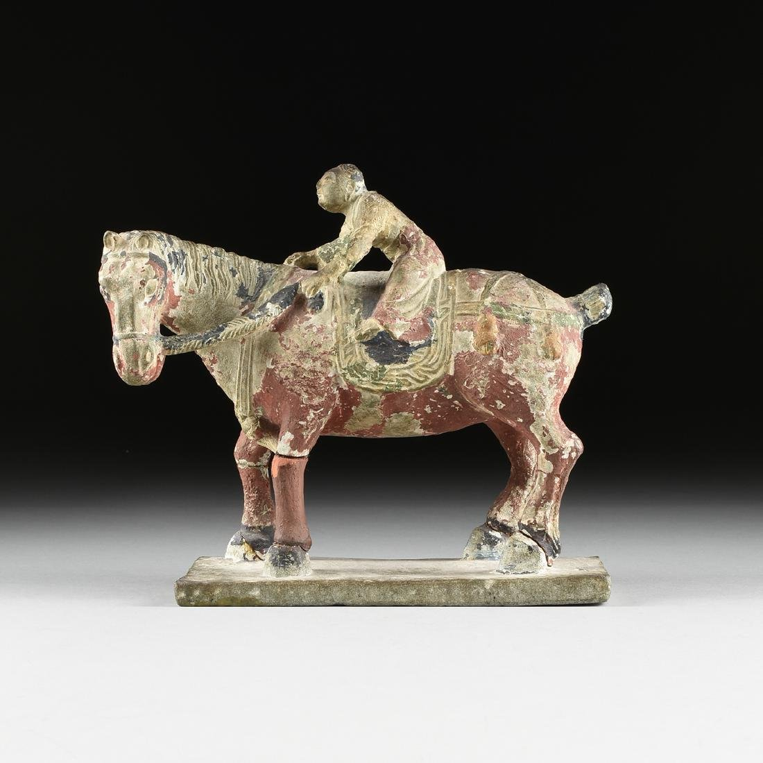 A TANG DYNASTY STYLE CARVED STONE STATUE OF A HORSE AND