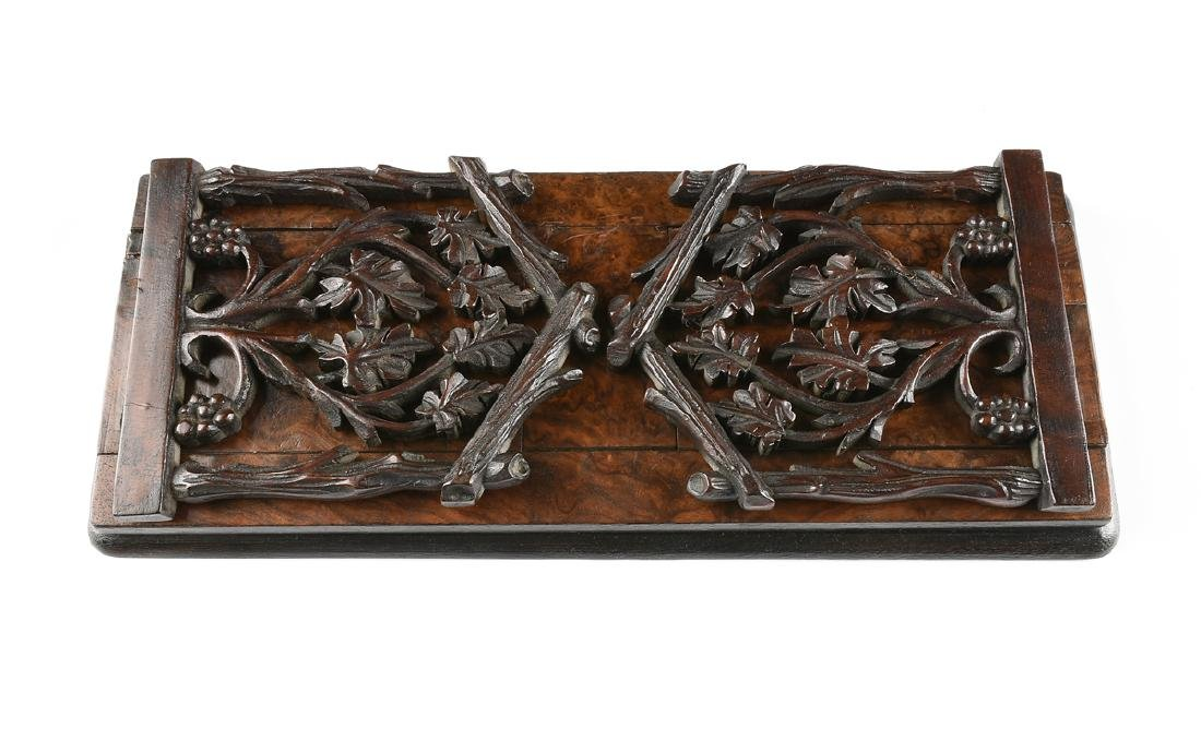 A BLACK FOREST CARVED MAHOGANY AND BURLED BLACK WALNUT