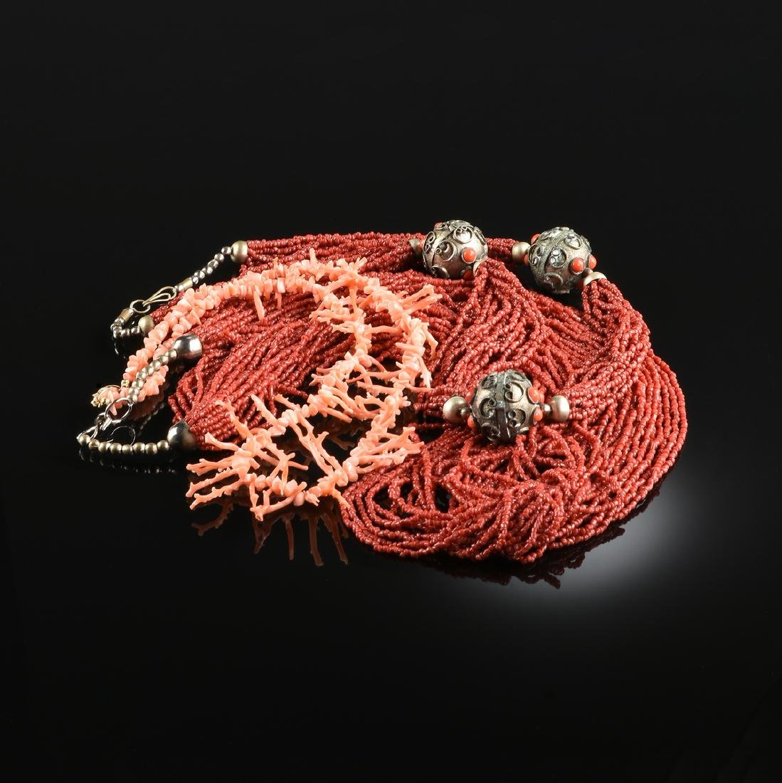 A GROUP OF THREE CORAL NECKLACES,