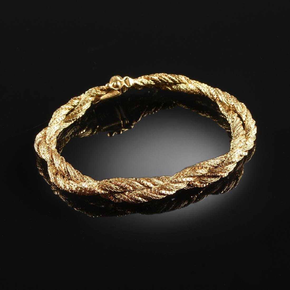 AN 18K YELLOW GOLD LADY'S BRACELET,