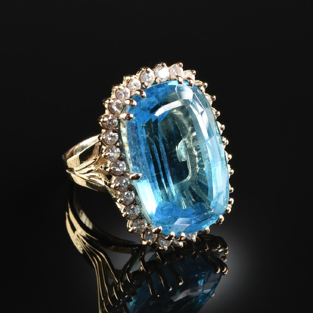 A 14K YELLOW GOLD, BLUE TOPAZ, AND DIAMOND LADY'S RING,