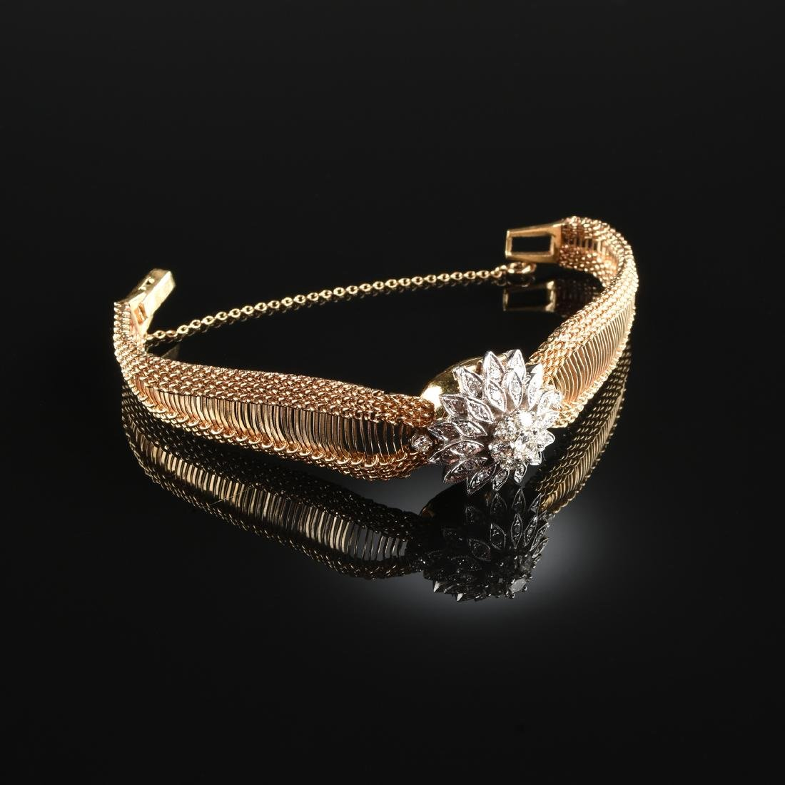 A 14K TWO TONE GOLD AND DIAMOND HAMILTON LADY'S