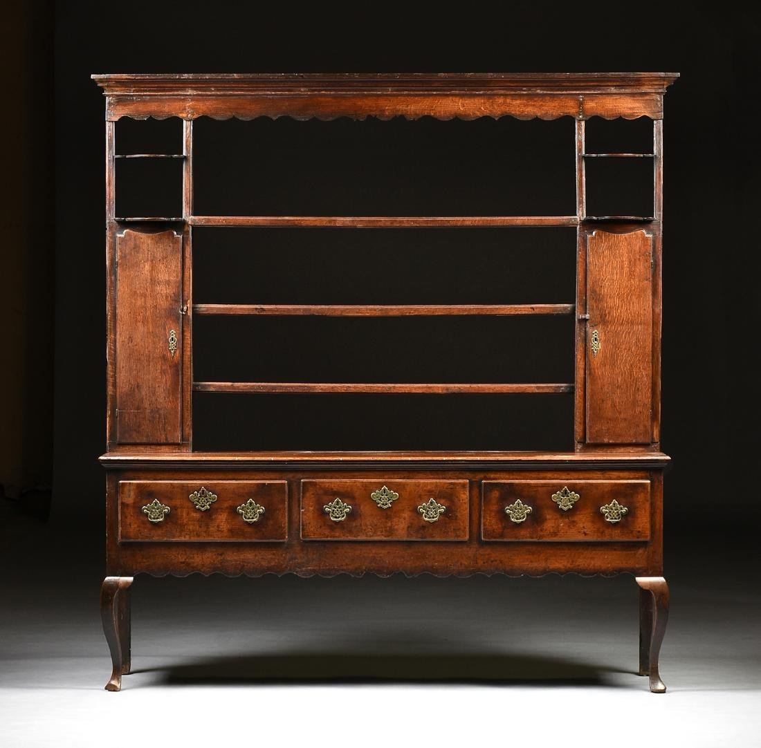 A GEORGE III QUEEN ANNE STYLE OAK AND ELM DRESSER,