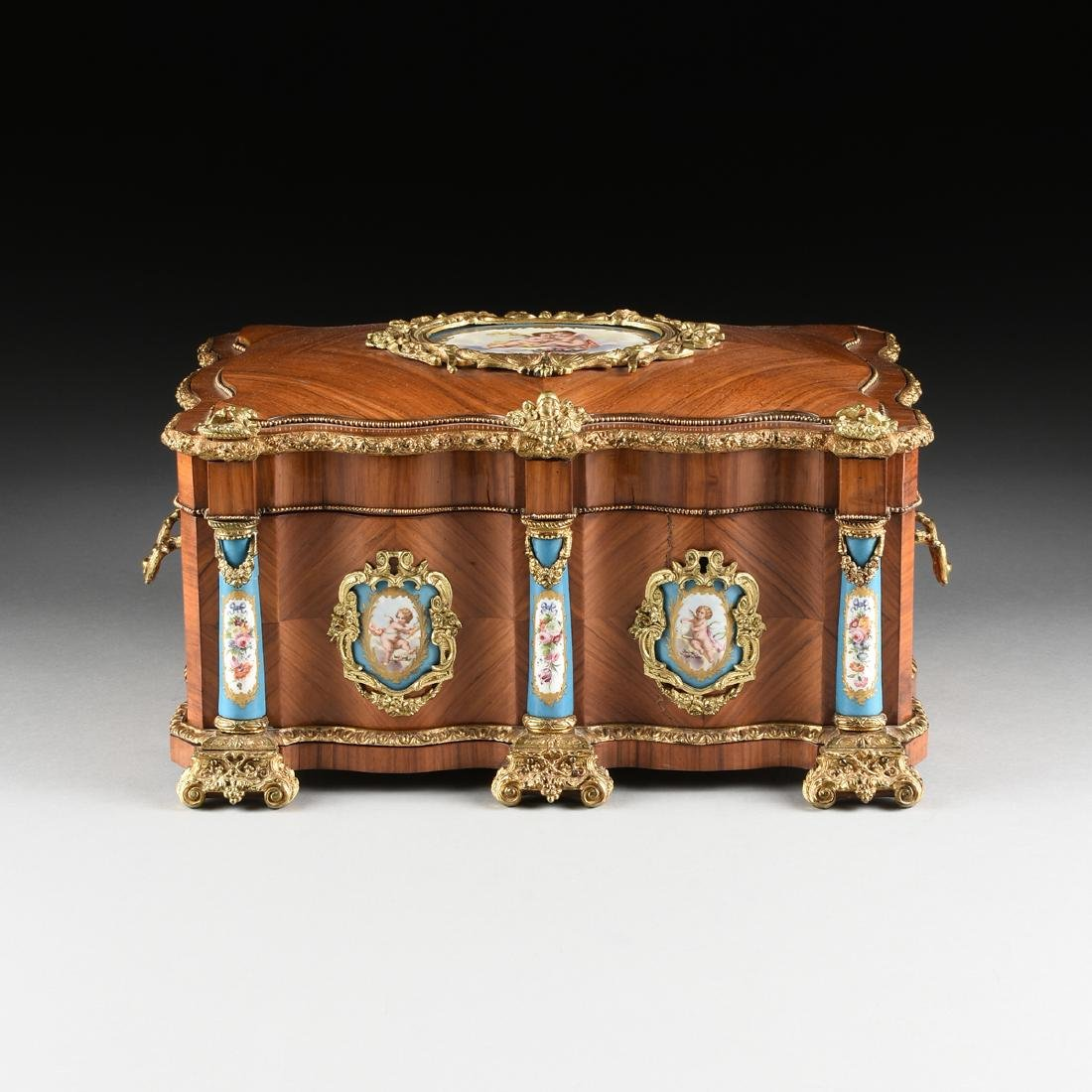 A NAPOLEON III GILT BRONZE AND PORCELAIN MOUNTED