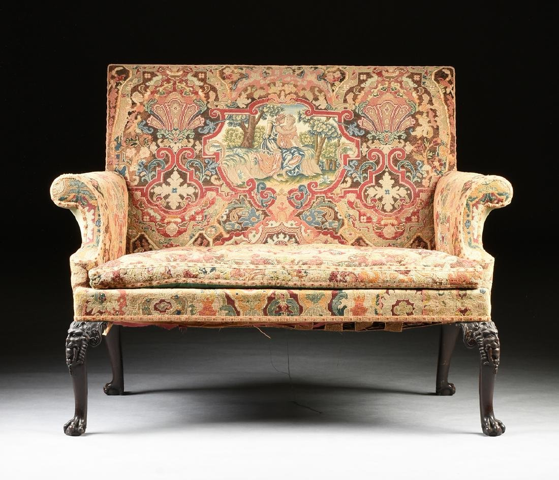 AN IRISH REGENCY STYLE CARVED MAHOGANY SETTEE, 19TH
