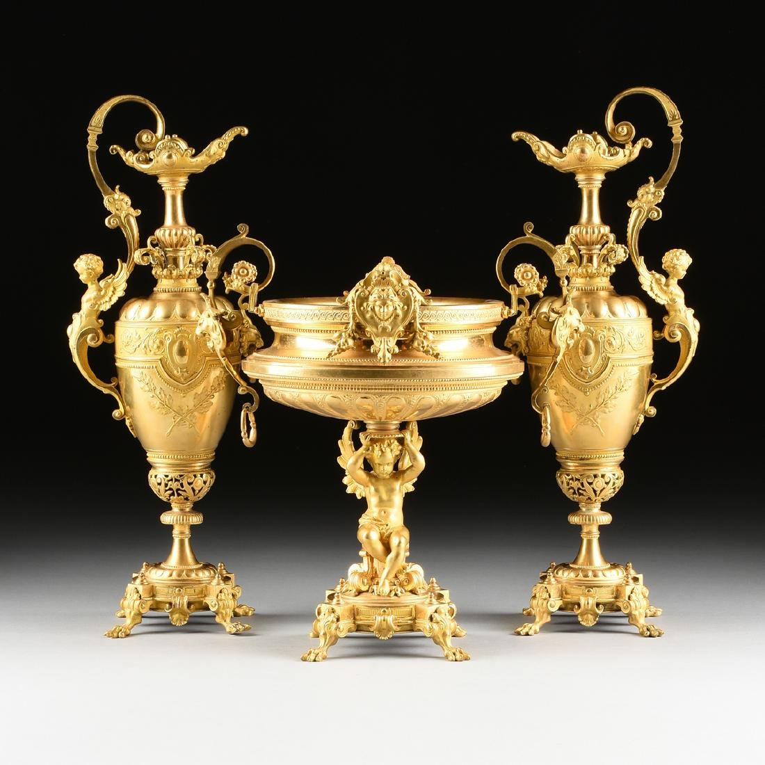 A THREE PIECE FRENCH NAPOLEON III STYLE TWO-TONE CAST