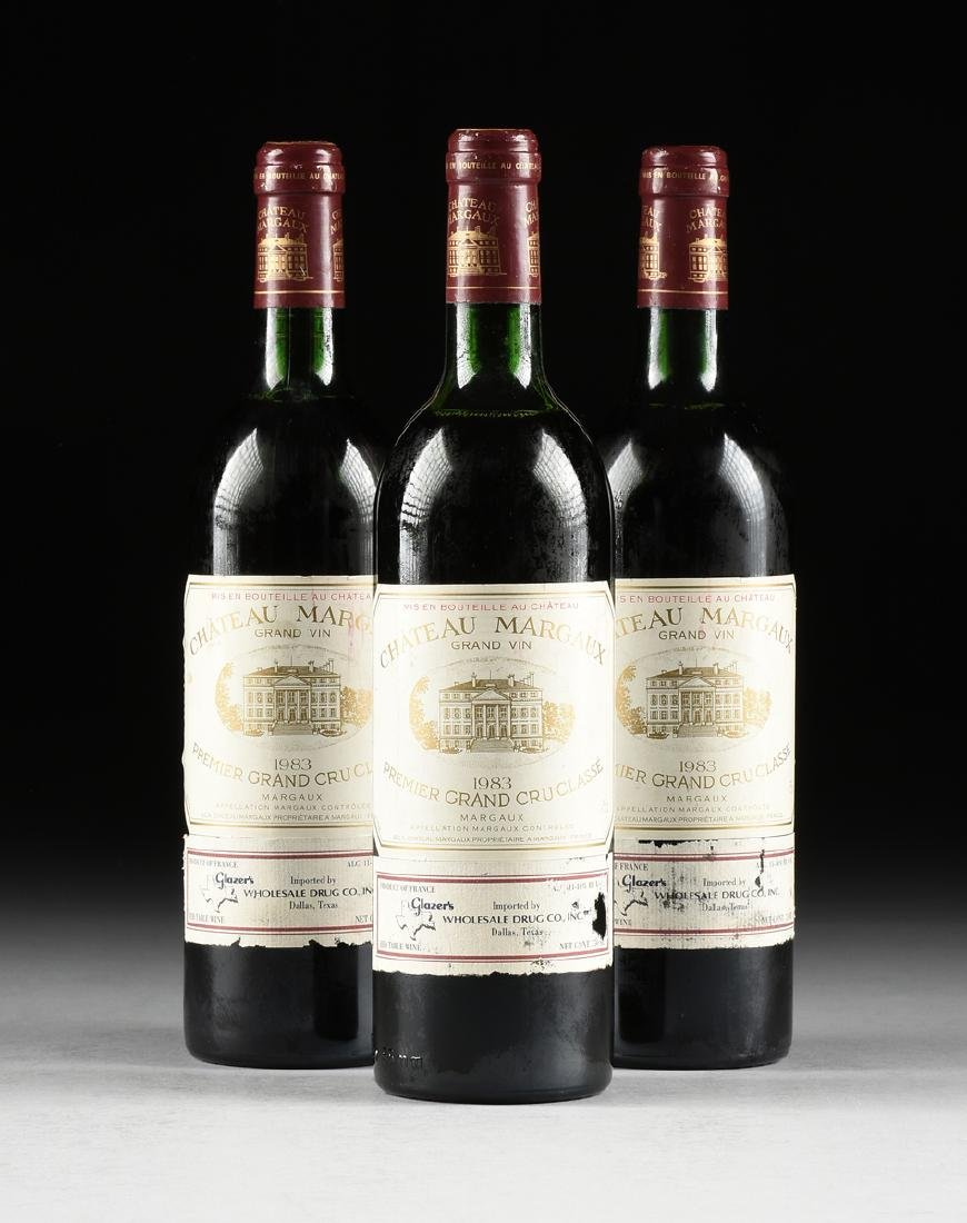 A GROUP OF THREE BOTTLES OF 1983 CHÂTEAU MARGAUX,