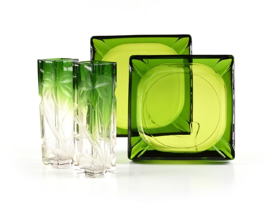 A GROUP OF FOUR GREEN GLASS VESSELS, CIRCA 1920-1970,