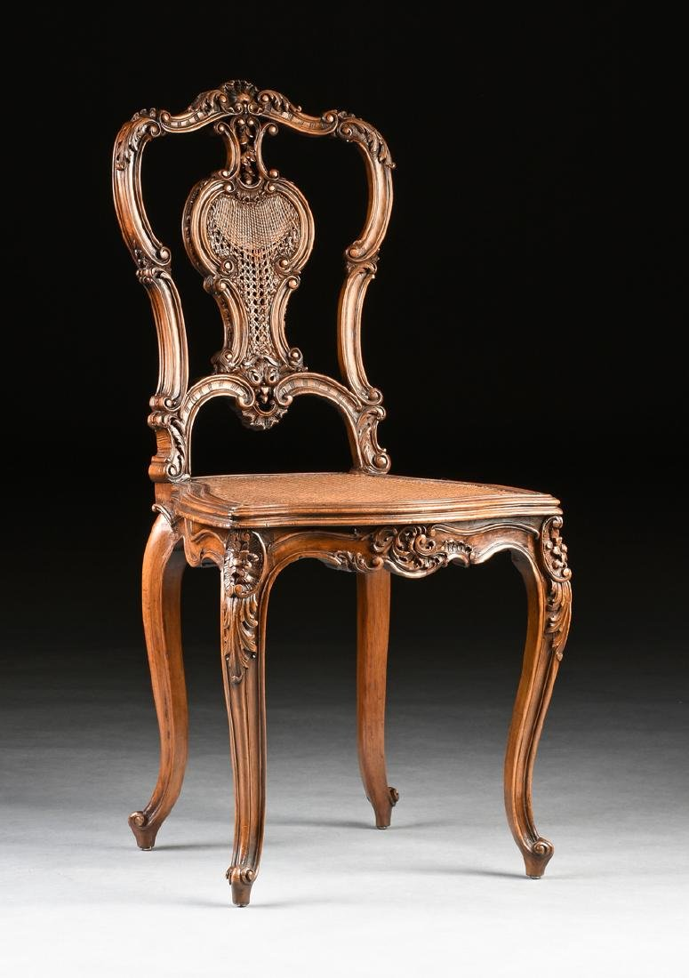 A CONTINENTAL ROCOCO REVIVAL WALNUT AND CANE BOUDOIR