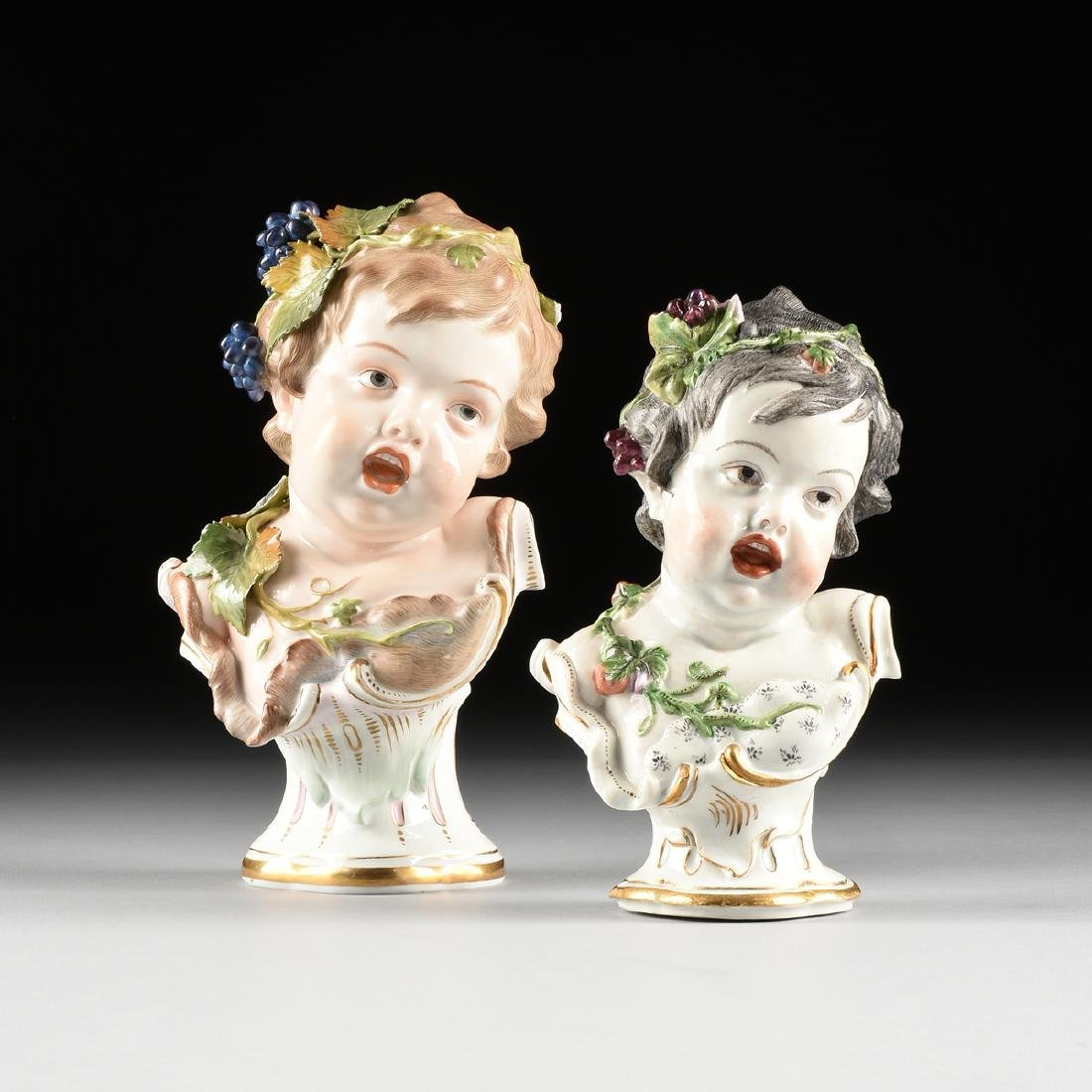 TWO HOCHST PAINTED PORCELAIN ALLEGORICAL BUSTS OF