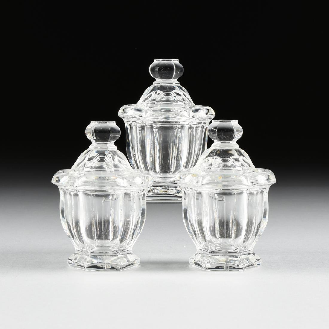 A SET OF THREE BACCARAT CRYSTAL LIDDED MUSTARD JARS,