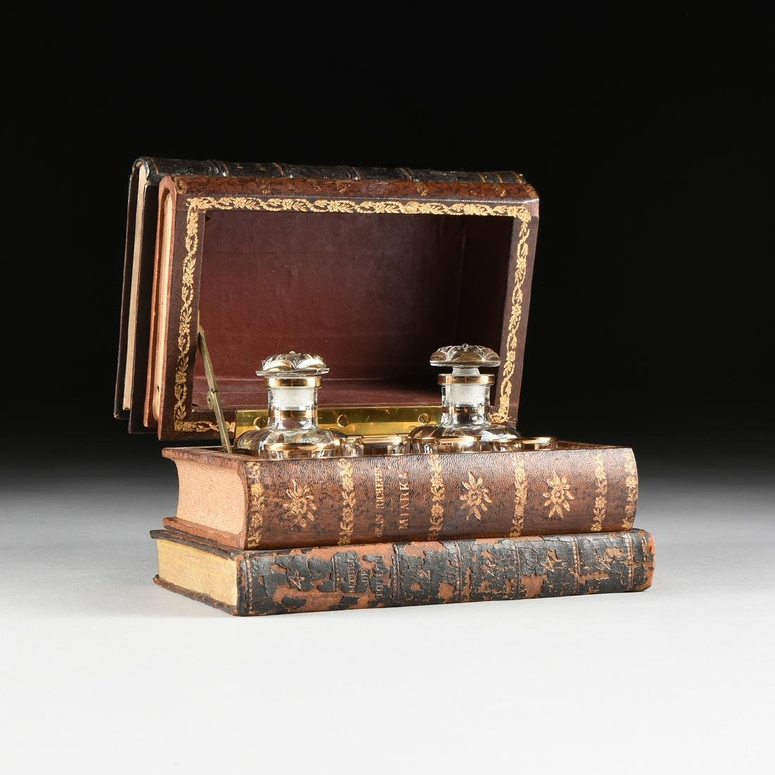 A FRENCH BOOK FORM FITTED TANTALUS, CIRCA 1920-1950,