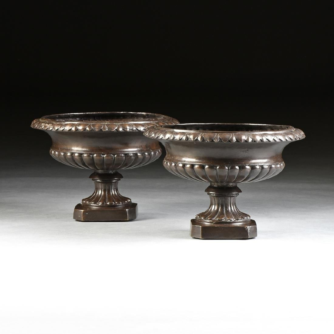 A PAIR OF ANCIENT ROMAN STYLE PATINATED BRONZE URN