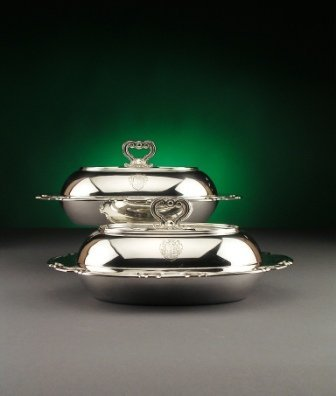 9: A PAIR OF TIFFANY STERLING SILVER ARMORIAL LIDDED EN