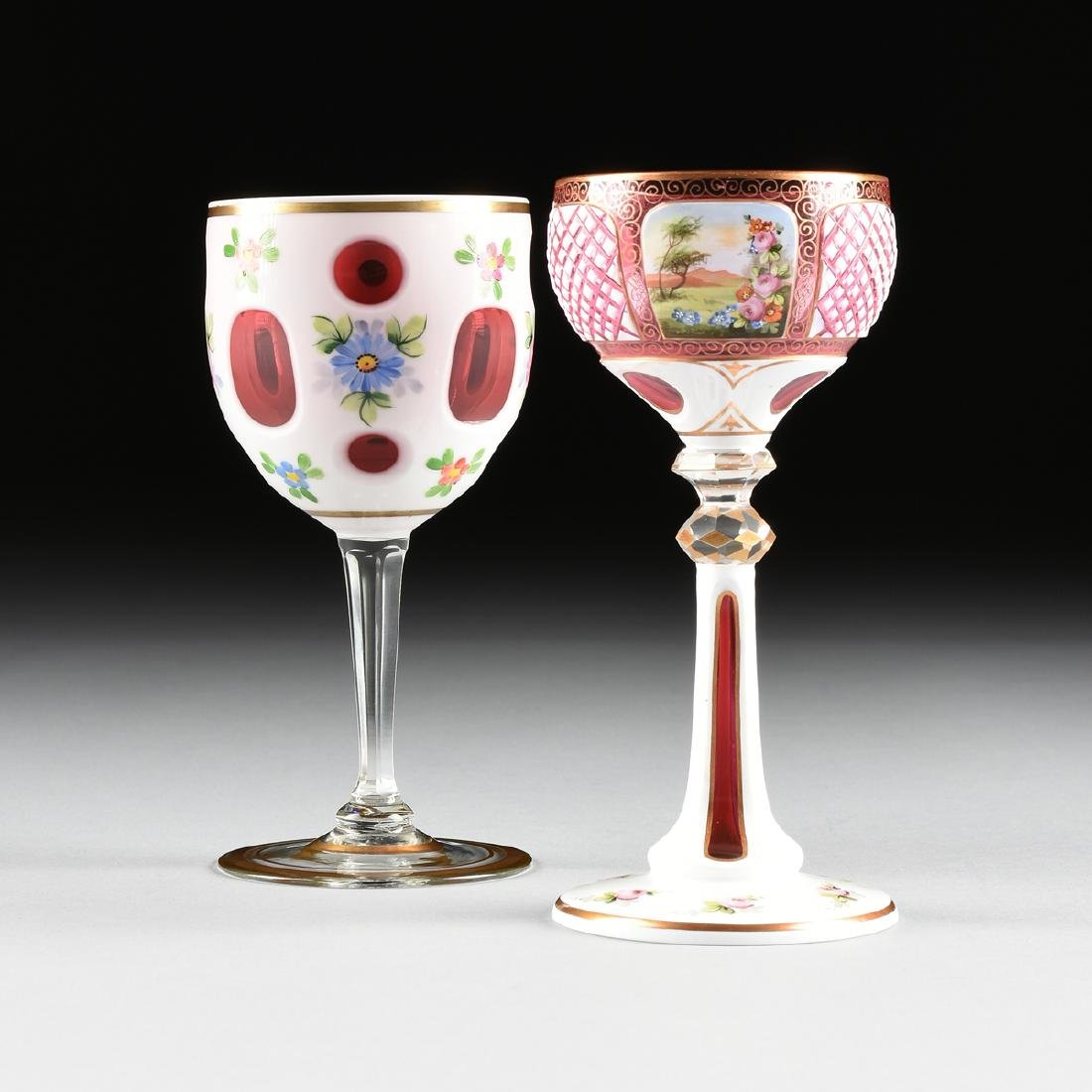 A GROUP OF TWO WHITE GLASS CUT TO CRANBERRY GLASSES,