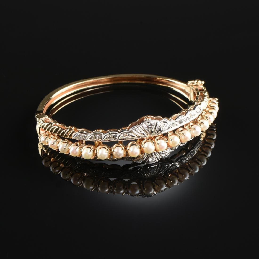 A 14K TWO TONE GOLD, PEARL, AND DIAMOND LADY'S