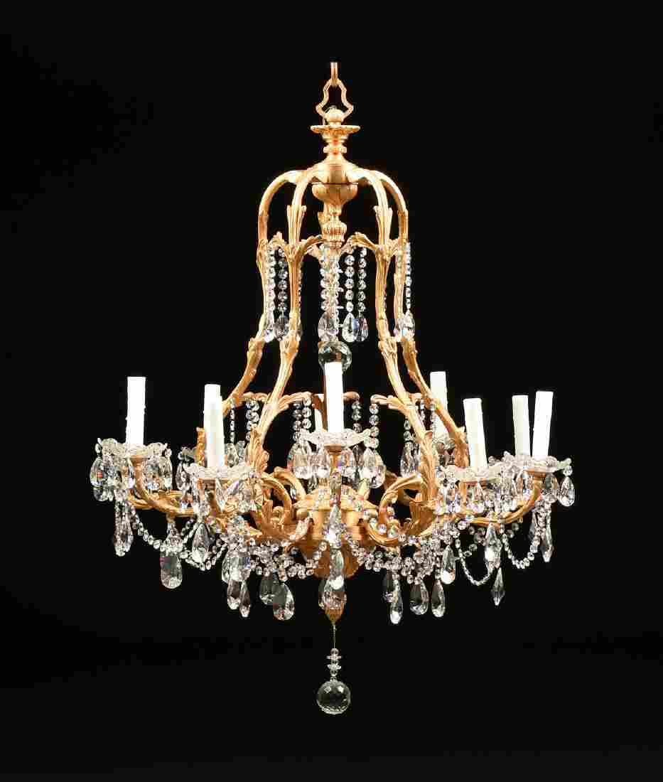 A LOUIS XV STYLE GILT BRONZE AND CRYSTAL TEN LIGHT