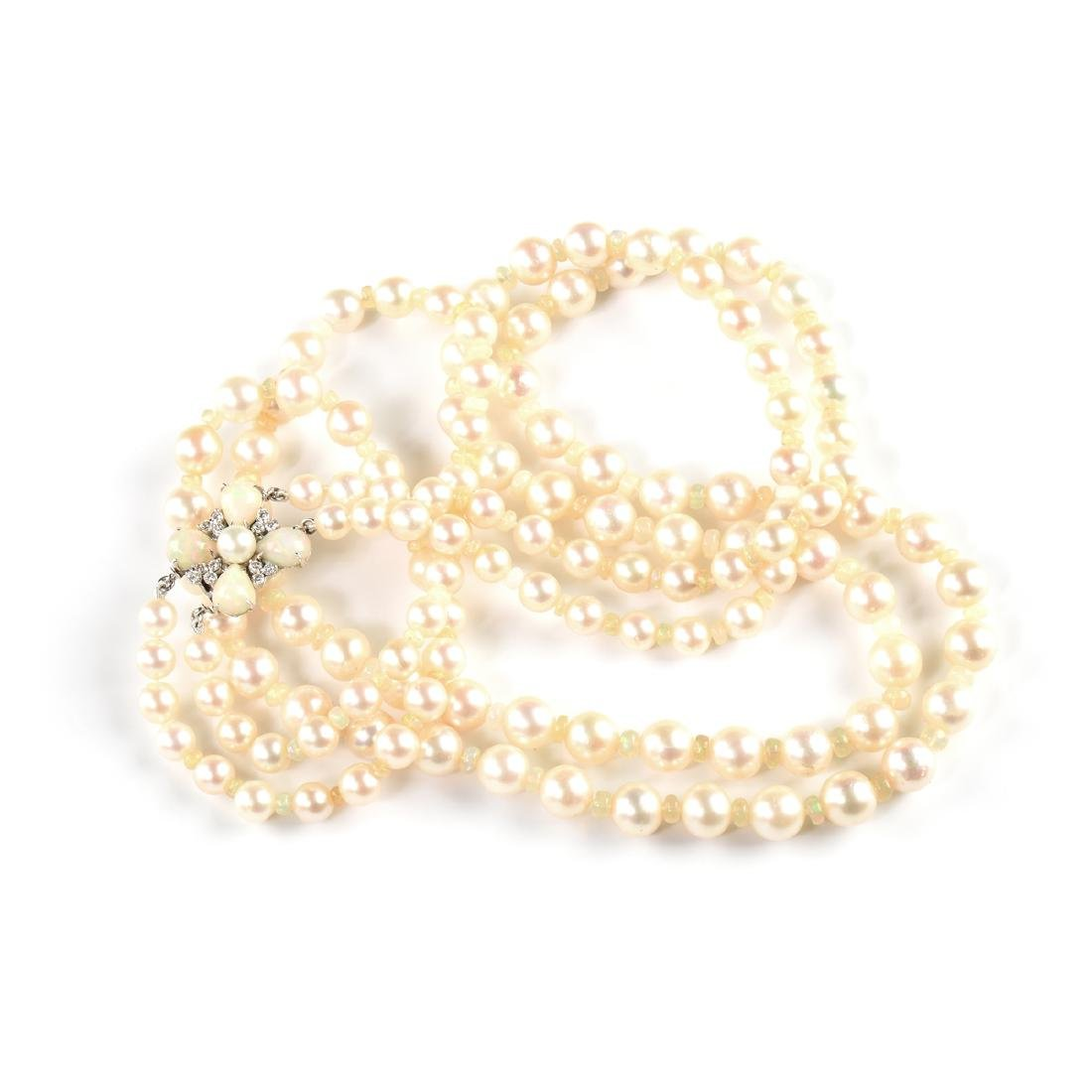 AN AKOYA DOUBLE STRAND PEARL NECKLACE WITH AN 18K WHITE