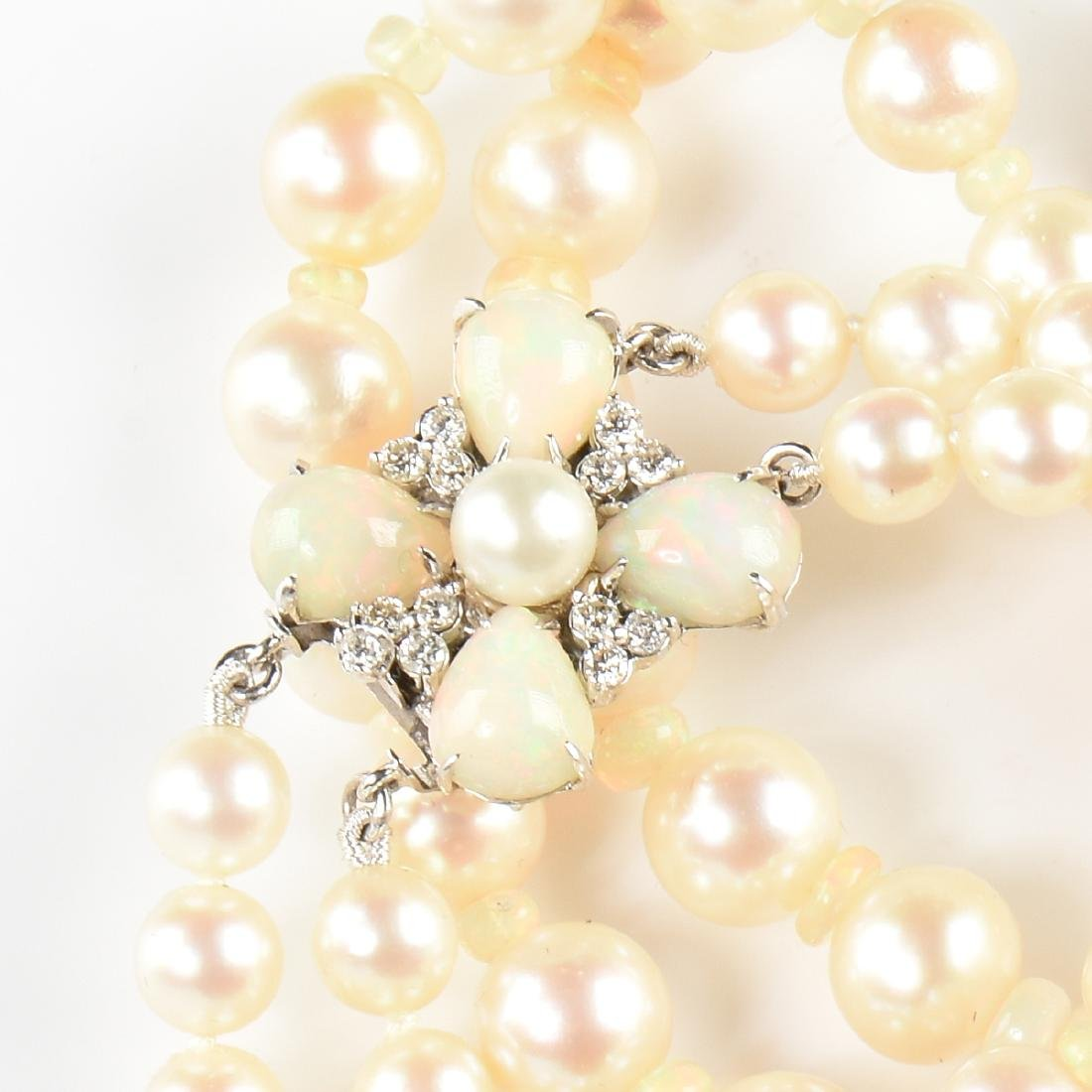 AN AKOYA DOUBLE STRAND PEARL NECKLACE WITH AN 18K WHITE - 2