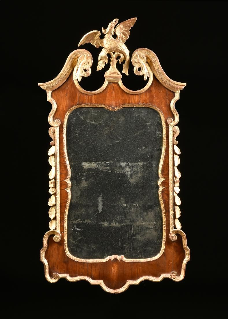 A GEORGE II PERIOD WALNUT AND CARVED GILTWOOD WALL