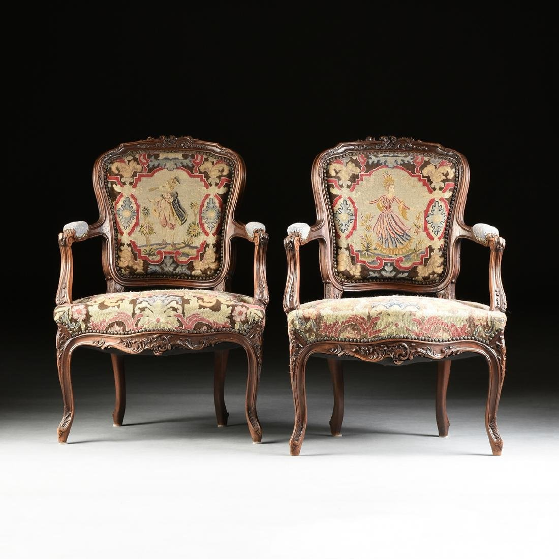 A PAIR OF LOUIS XV STYLE NEEDLEPOINT UPHOLSTERED WALNUT