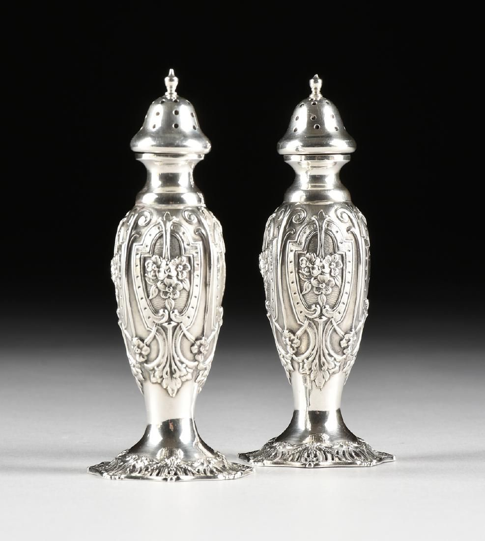 A PAIR OF GRAFF, WASHBOURNE AND DUNN STERLING SILVER