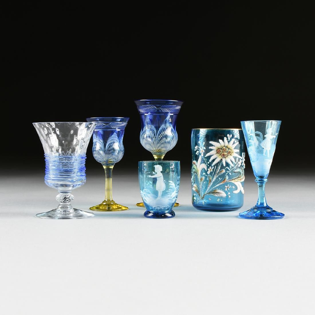 A GROUP OF SIX AMERICAN AND BOHEMIAN BLUE GLASS