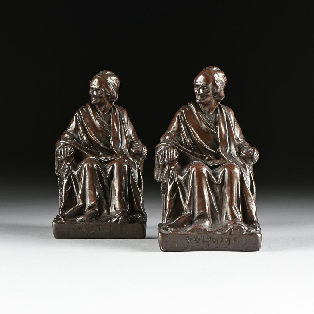 A PAIR OF CAST, PATINATED, AND LACQUERED  BRONZE