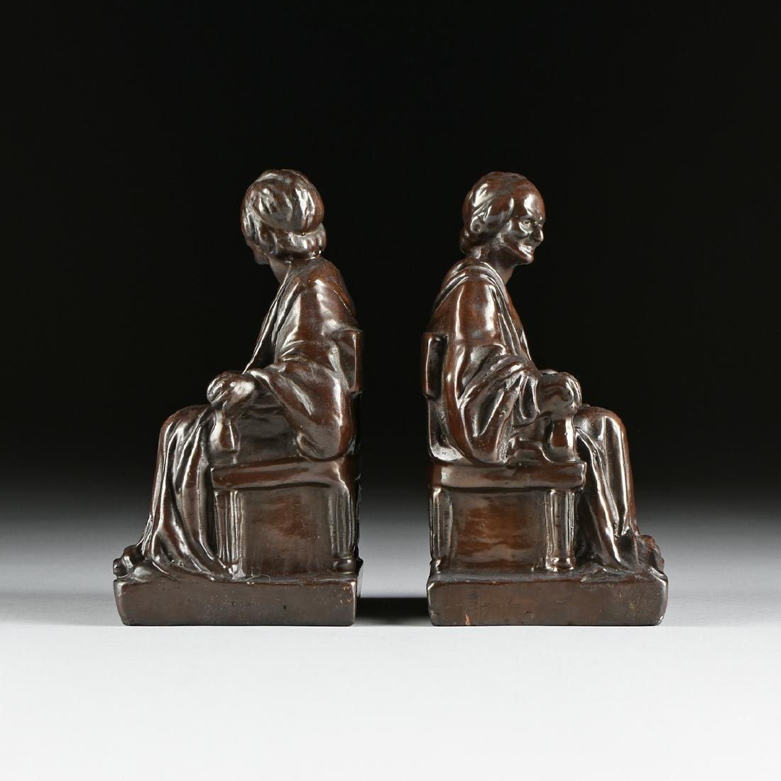 A PAIR OF CAST, PATINATED, AND LACQUERED  BRONZE - 2