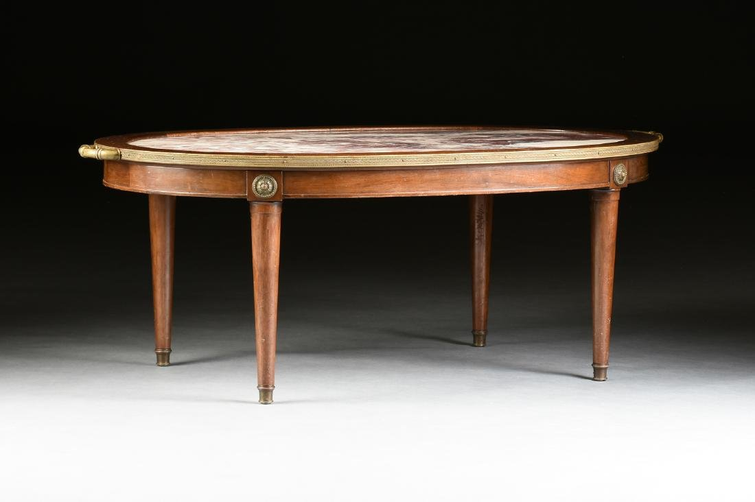 A LOUIS XVI STYLE GILT BRONZE MOUNTED AND CARVED WALNUT