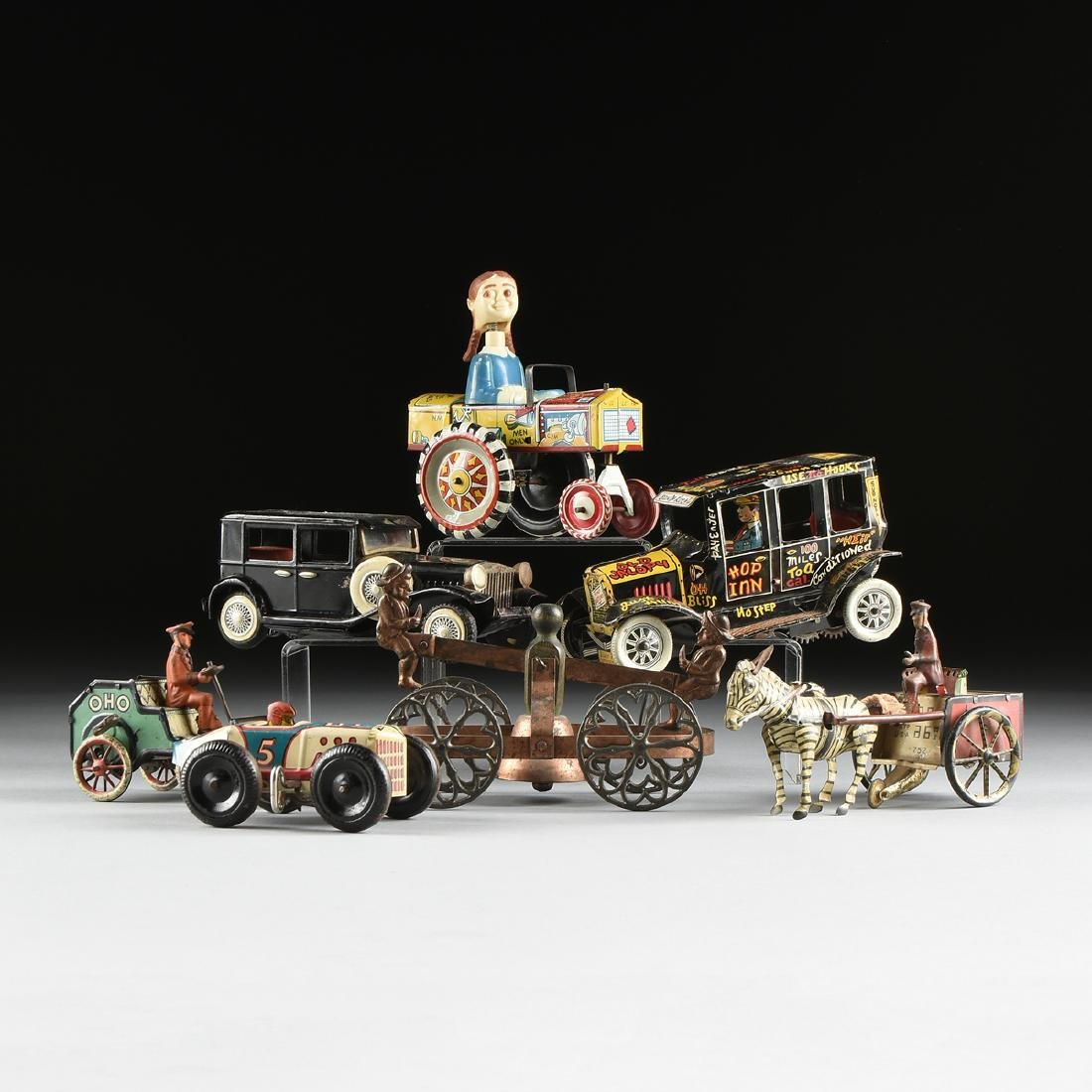 A GROUP OF SEVEN TIN AND METAL CHILD'S TOYS ON WHEELS,