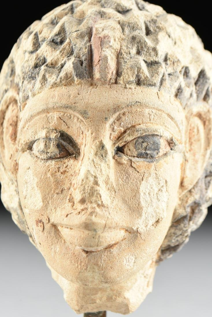 AN ANCIENT EGYPTIAN CARVED AND PAINTED LIMESTONE - 2