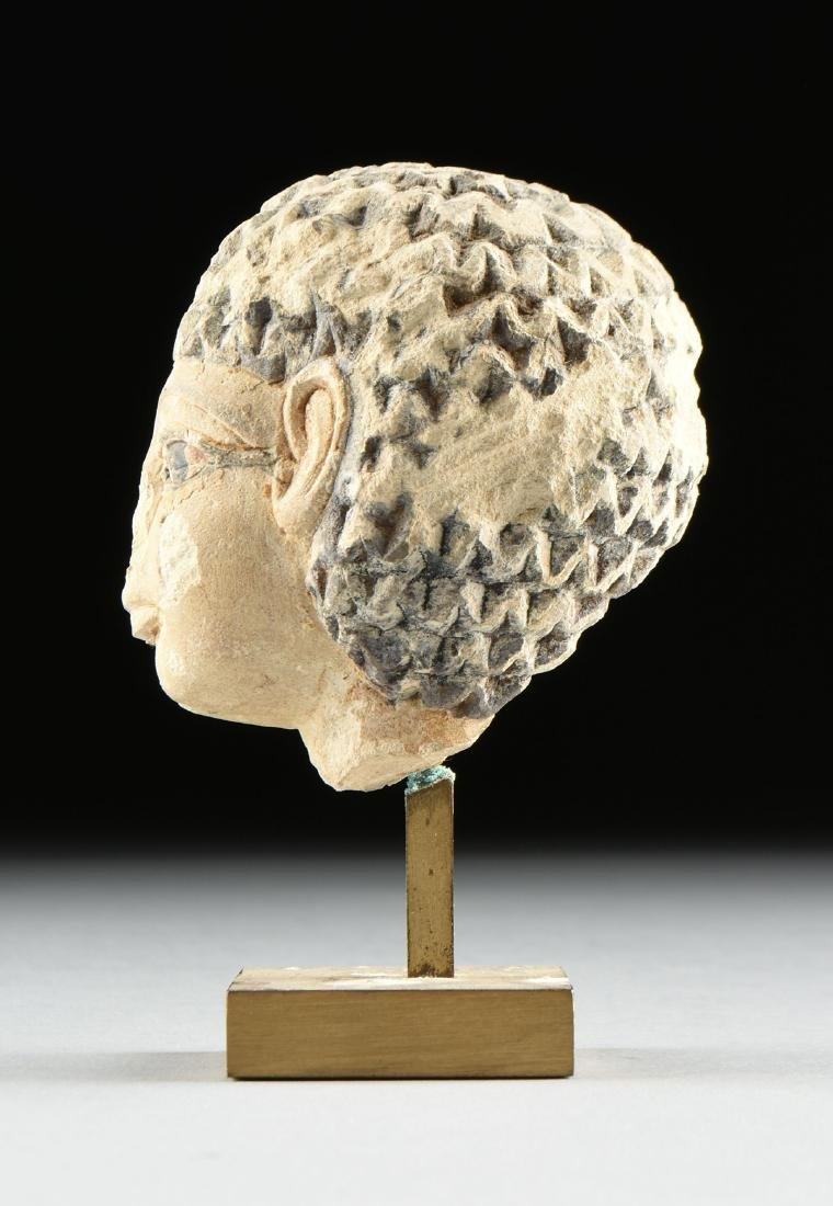 AN ANCIENT EGYPTIAN CARVED AND PAINTED LIMESTONE - 7