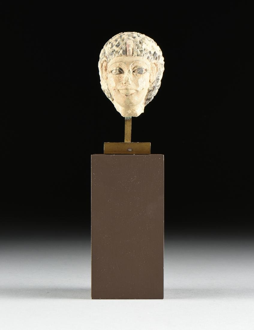 AN ANCIENT EGYPTIAN CARVED AND PAINTED LIMESTONE - 9