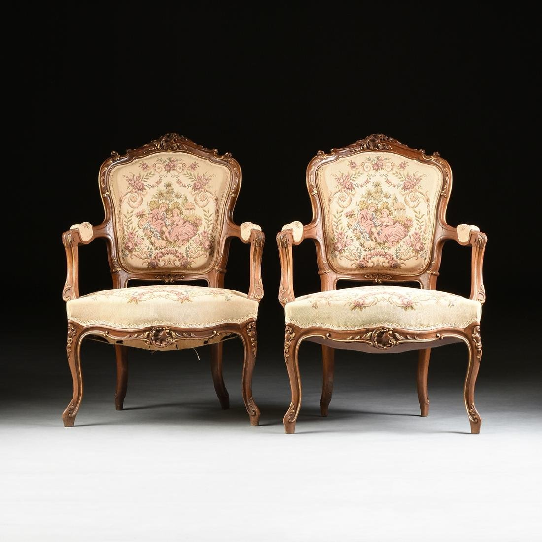 A PAIR OF LOUIS XV REVIVAL PARCEL GILT CARVED WALNUT
