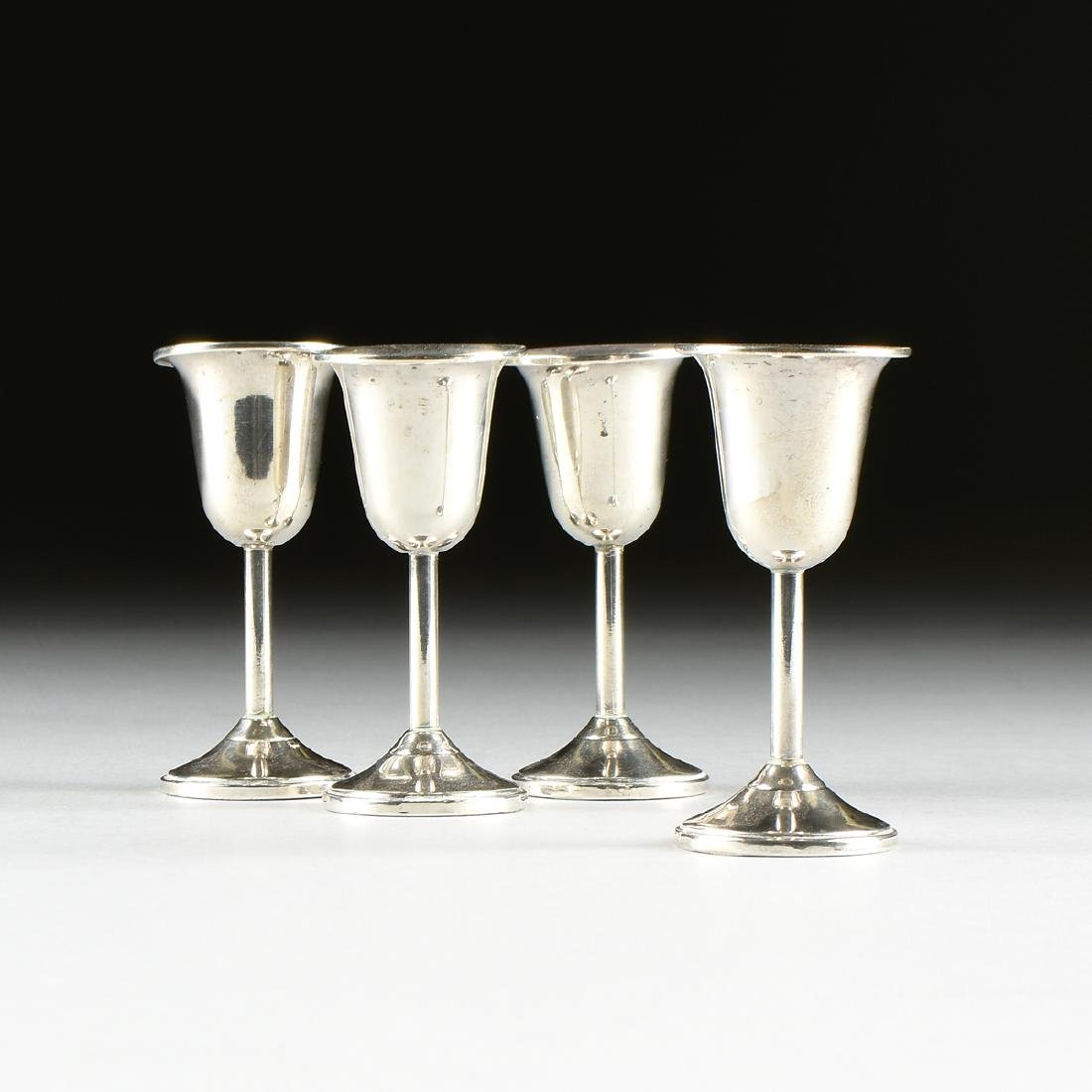 A SET OF FOUR M. FRED HIRSCH CO. WEIGHTED STERLING